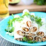 Baked Chipotle Chicken Flautas with Avocado Garlic Sour Cream