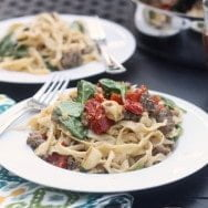 Fresh Fettuccine with Sun-dried Tomatoes, Roasted Garlic and Turkey Italian Sausage in a Sweet Sage Vermouth Sauce