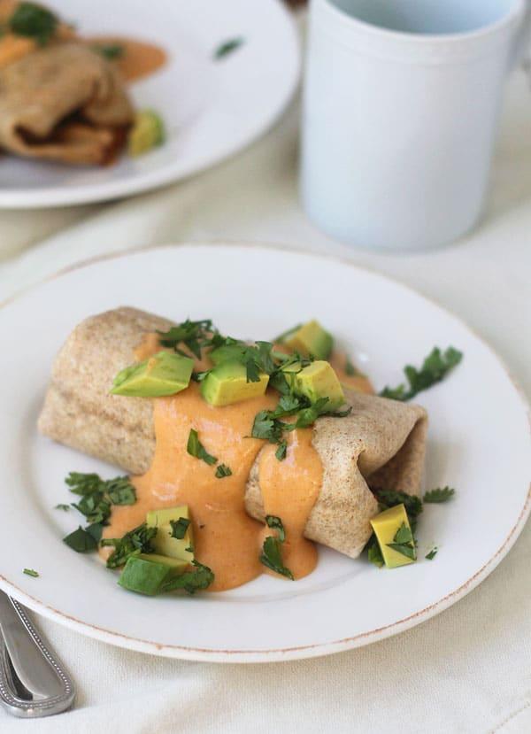 Chorizo and Egg Breakfast Burritos with Pumpkin Goat Cheese Cream Sauce
