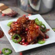 Sticky Baked Chicken Wings with Sweet & Spicy Pomegranate Glaze