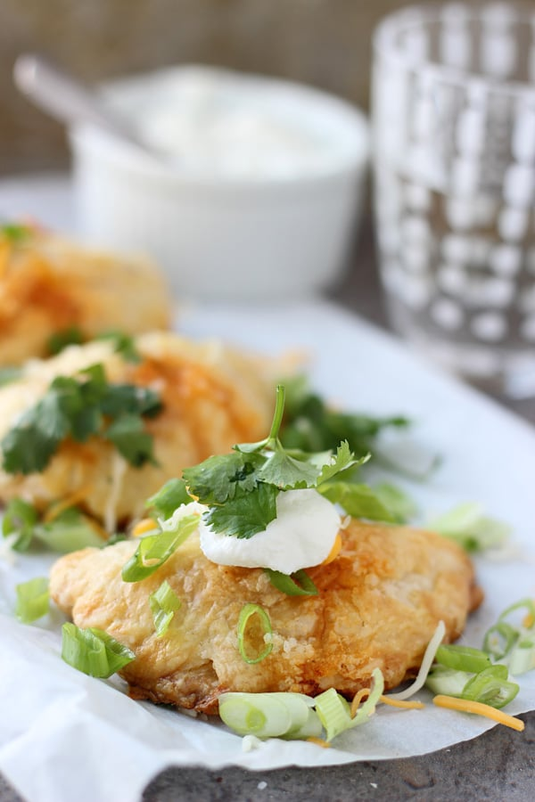 Chicken Enchilada Empanadas - All you favorite enchilada flavors stuffed into puff pastry and made portable!