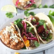 Slow-Cooker Pomegranate Pork Tacos with Cutie Jalapeño Salsa and Quick Pickled Red Onions
