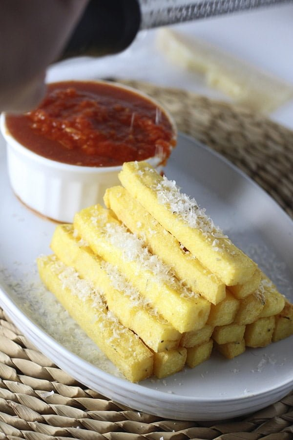 Crispy Baked Polenta Fries with Spicy Tomato Dipping Sauce via cookingforkeeps.com