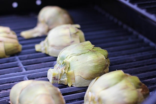 Grilled Artichokes with Rosemary Lemon Vinaigrette and Garlic Breadcrumbs via cookingforkeeps.com