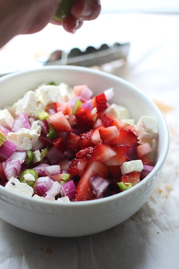 Blackened Chicken Thighs with Strawberry Feta Salsa via cookingforkeeps.com