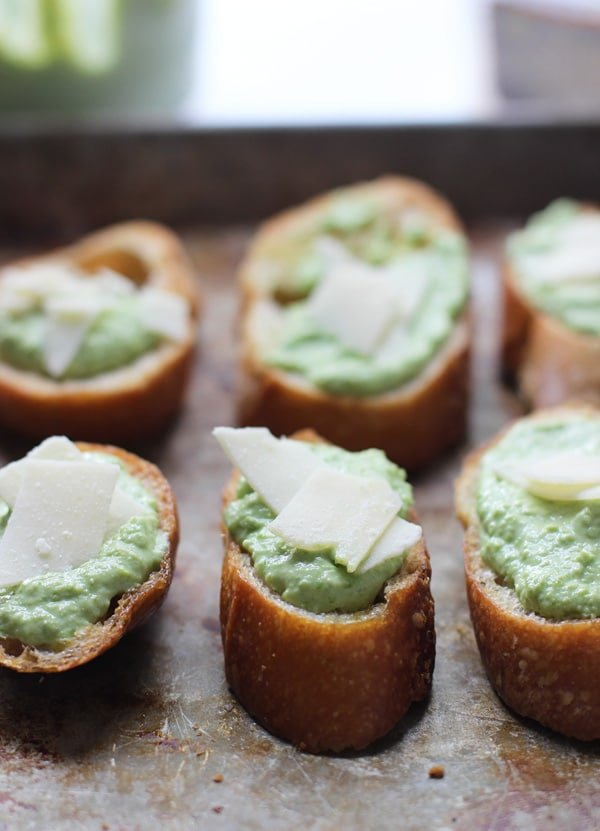 Baby Pea and Ricotta Crostini via cookingforkeeps.com