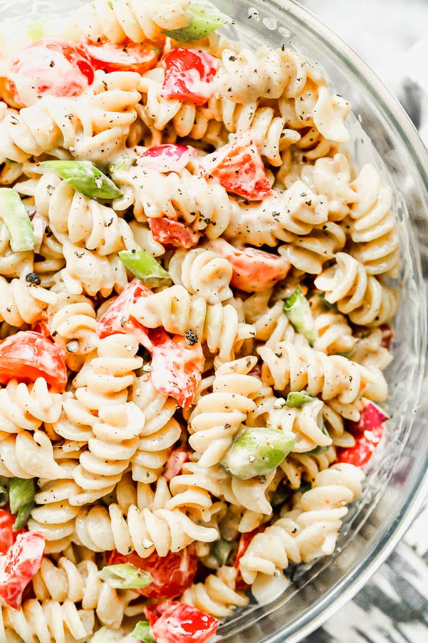 This is The BEST Creamy Pasta Salad you will ever make, promise. Thanks to one secret ingredient, this classic creamy pasta salad is infinitely flavorful. Throw in your favorite veggies, cook up your favorite pasta, and watch this easy pasta salad disappear.