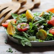 Garden Pickles & Heirloom Tomatoes Over Baby Greens