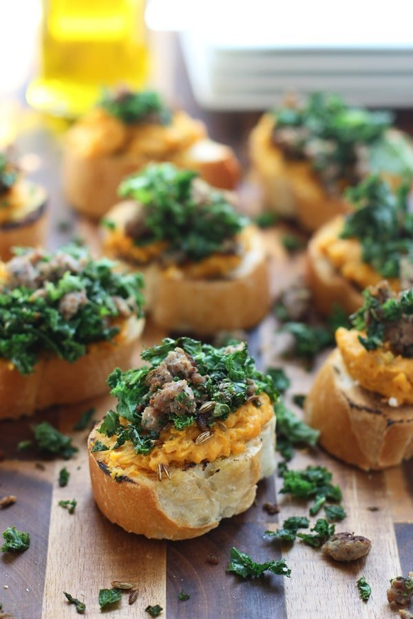 Whipped Ricotta and Butternut Squash Crostini with Sauteed Kale and Italian Sausage