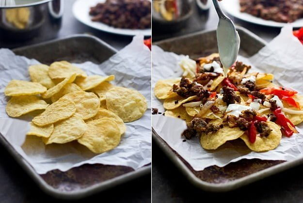 Italian Style Nachos - Layers of spicy italian sausage, roasted red peppers, fontina cheese and a creamy cheese sauce are the spin on a classic nacho!