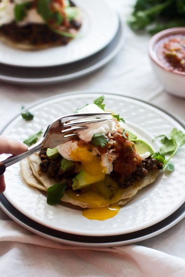 Mexican Breakfast Tostadas with Chorizo Re-fried Beans, Avocado and Poached Eggs