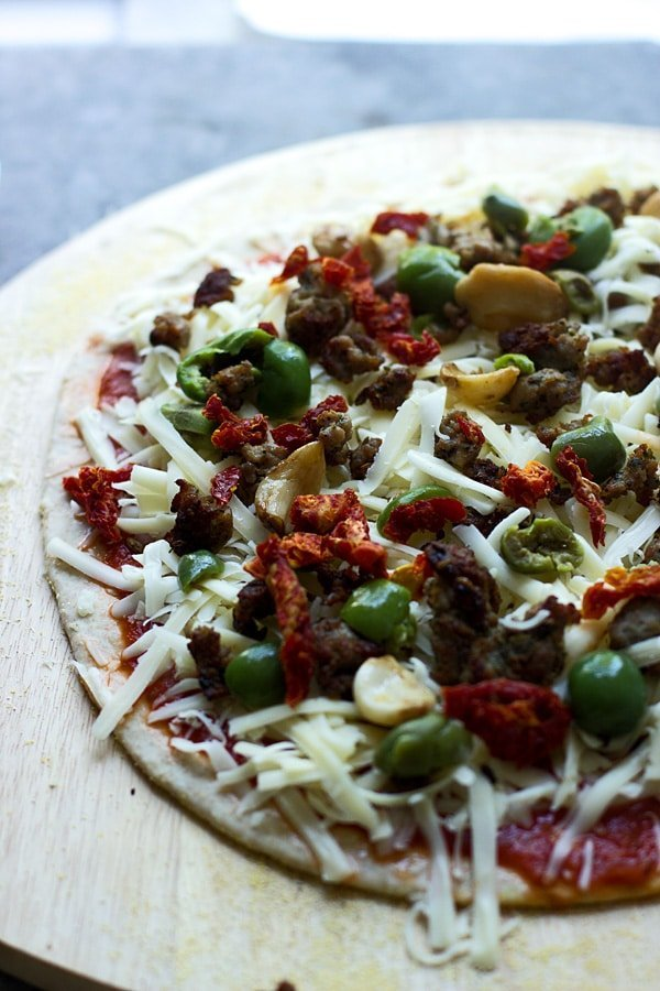 Spanish Olive, Roasted Garlic and Sun-Dried Tomato Pizza + How to make restaurant-quality pizza at home every time!