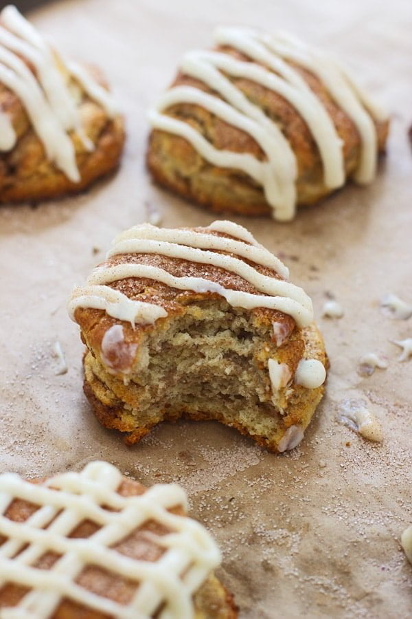 Cinnamon Roll Butterilk Biscuits - Super flaky layers of dough sprinkled with cinnamon and sugar and drenched in cream cheese frosting.