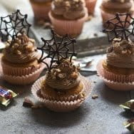 Pumpkin Snickers Cupcakes with Chocolate Buttercream and Edible Spiderwebs