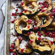 Brown Butter Roasted Acorn Squash with Toasted Hazelnuts, Pomegranates and Squash Seeds