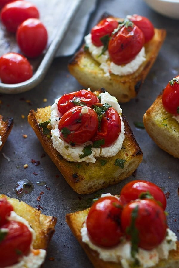 Grilled Baguette with Homemade Ricotto, Burst Cherry Tomatoes, and Chimichurri