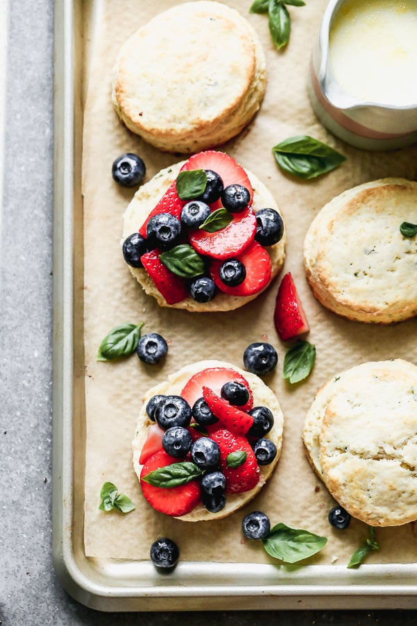 Once you try our Lemon Strawberry Shortcakes with Warm Sweet Cream, you may never be able to eat another dessert again. We take super-soft lemon and basil shortcakes, fill them with macerated berries, and then drown them in warm sweetened cream. Heaven on earth.