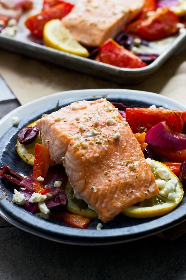Easy One Pan Greek Salmon with roasted tomatoes, lemon, olives and feta cheese