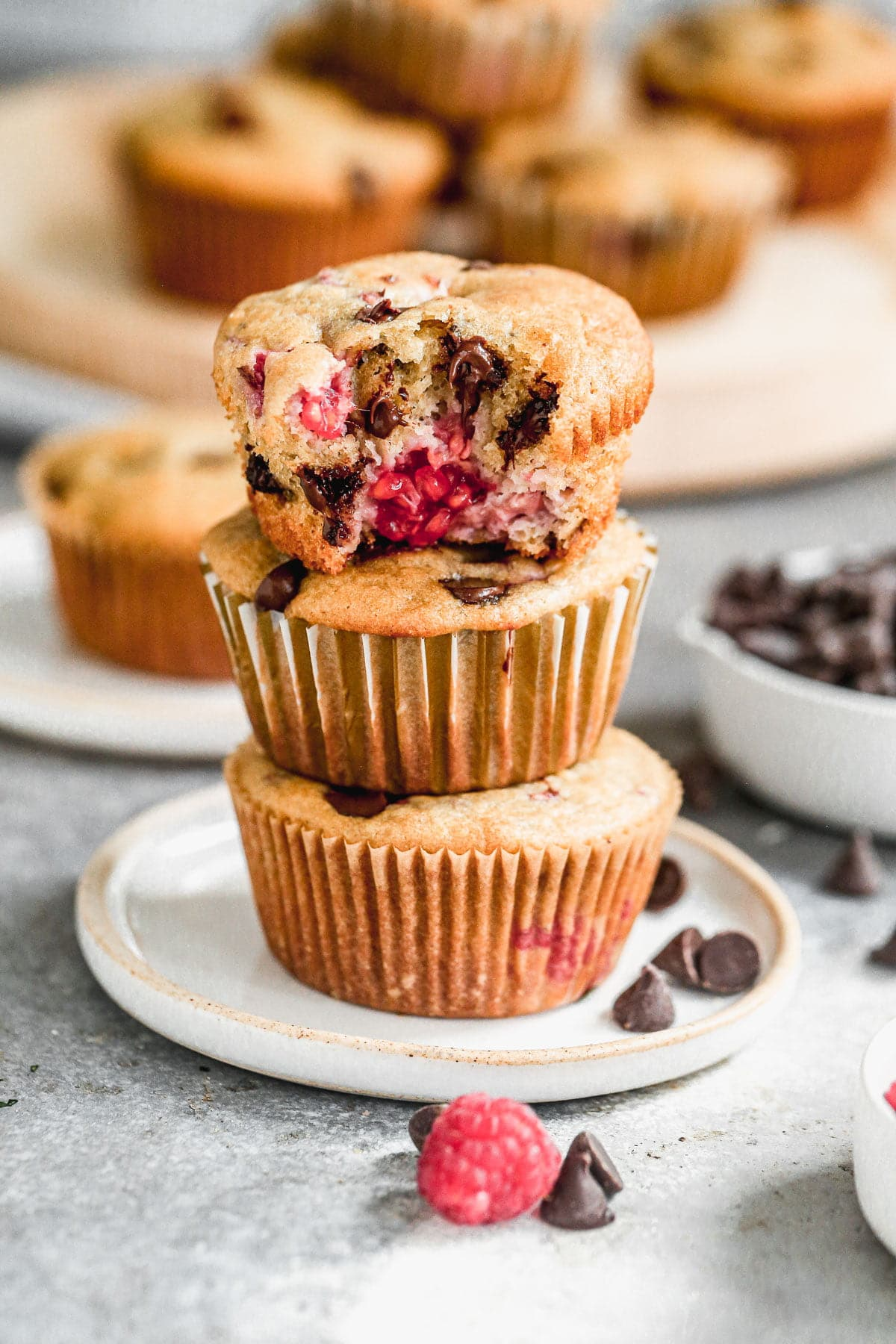 These one bowl Chocolate Raspberry Muffins are light, fluffy and full of gooey chocolate raspberry flavor. Made with protein-packed Greek yogurt, coconut oil and whole-wheat flour, they also have a good dose of healthiness so you don't have to feel completely guilty indulging. Perfect way to kickstart your day or nestle in a sweet pick-me-up in the afternoon.