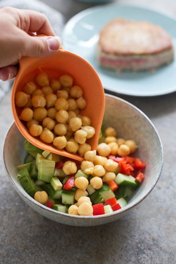 Chickpea salad with cucumber, red pepper, avocado, cilantro and queso fresca