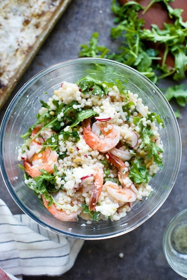 Tossing couscous and shrimp salad