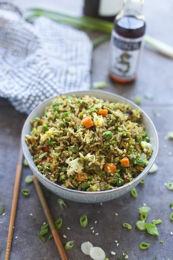 Broccoli fried rice and brown fried rice with chopsticks