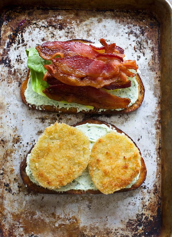 Fried green tomatoes, bacon and herbed goat cheese on sourdough bread