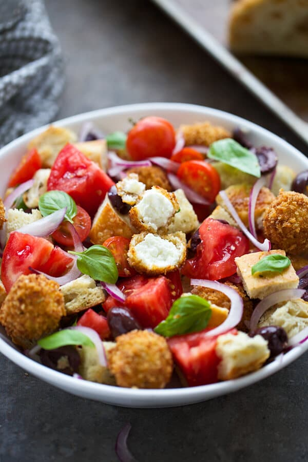 Bread salad with tomatoes, red onion, kalamata olives, basil, goat cheese and vinaigrette