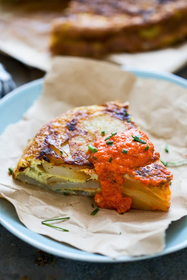 Tortilla Española with Roasted Red Pepper Goat Cheese Sauce - A classic Spanish tapa!