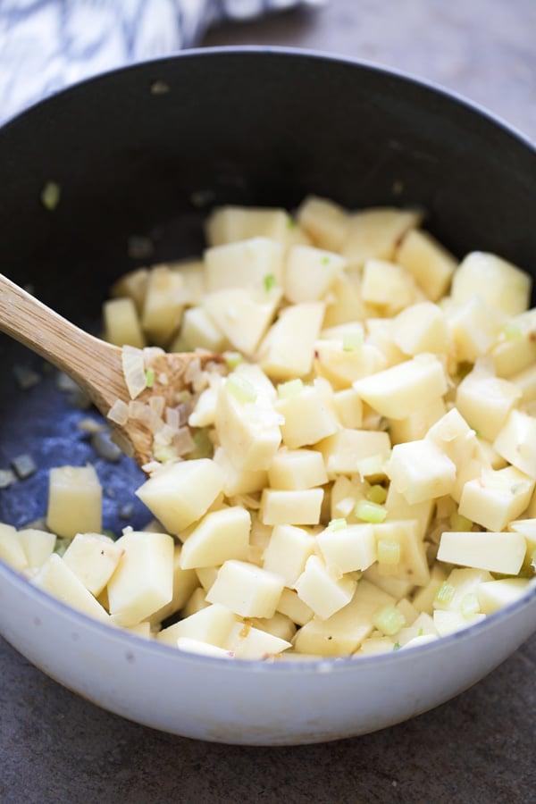 Saute potatoes, celery and onion