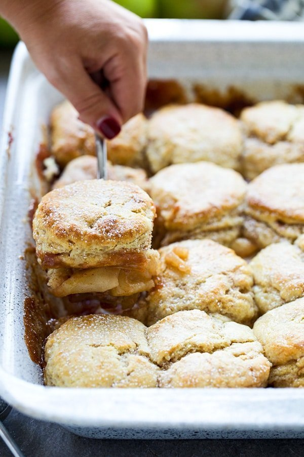 Easy Apple Cobbler with Sweet Cream - Flaky cinnamon biscuits top an easy apple filling for a sweet twist on a classic!