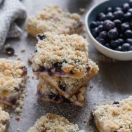 Blueberry Peach Cheesecake Crumble Bars