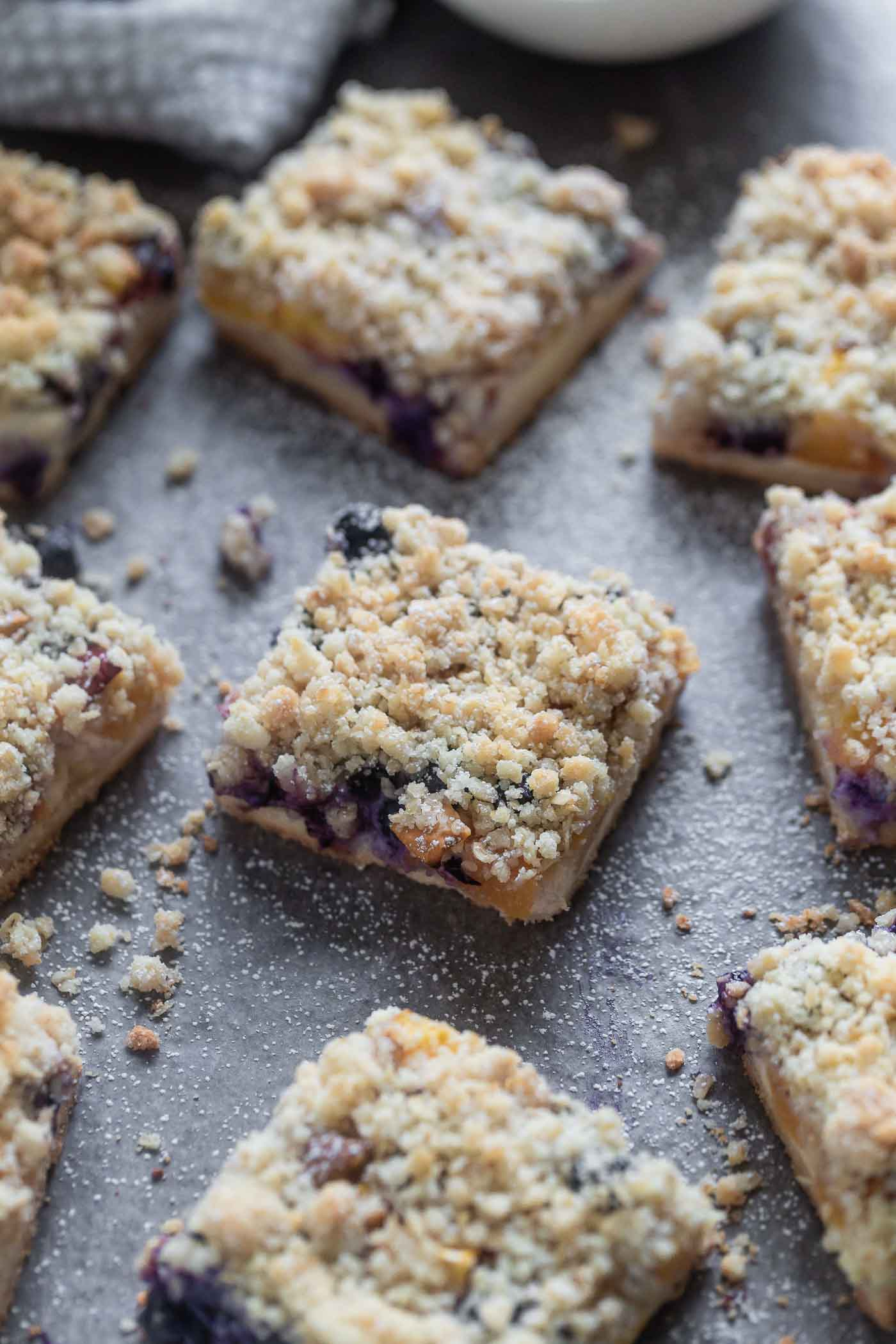 Blueberry Peach Cheesecake Crumble Bars
