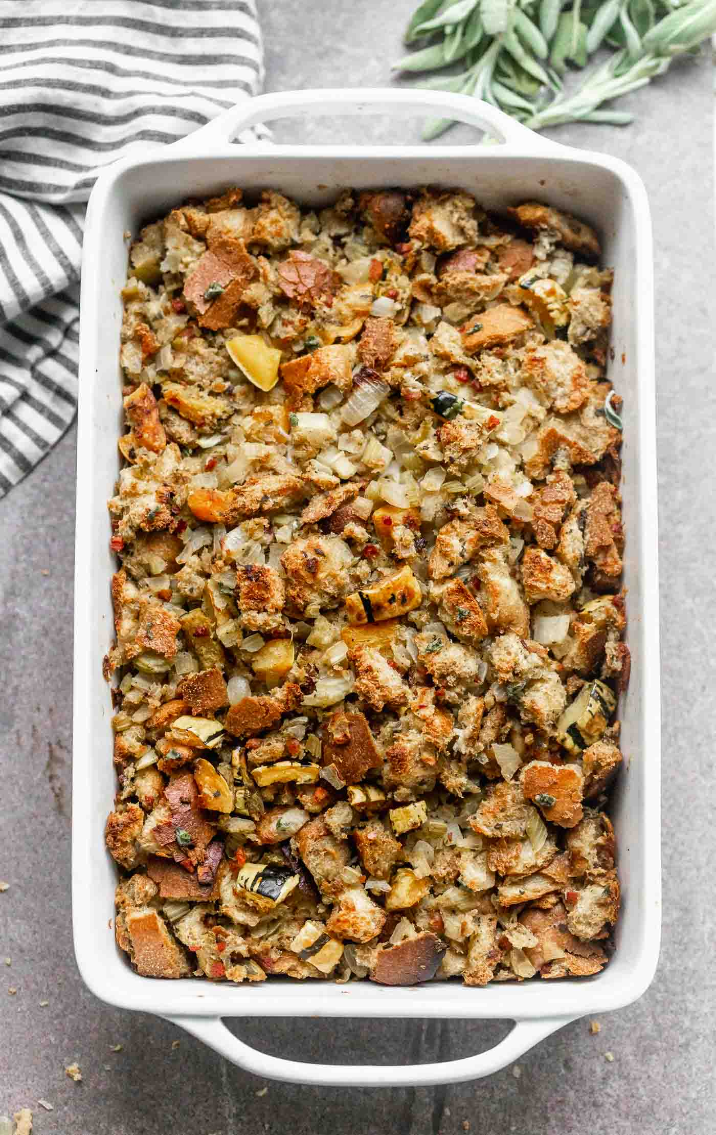 Delicata Squash, Sage and Pancetta Stuffing is a classic stuffing, updated. It has the flavor of the original with the addition of sweet squash, salty pancetta and nutty brown butter. A crowd pleaser for sure!
