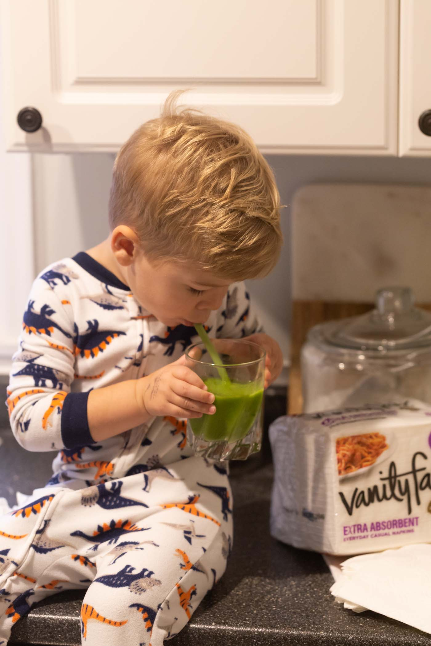 Vanity Fair® Napkins and Our Favorite Green Smoothie made with frozen mango, pineapples, banana, flax seed, TONS of spinach and unsweetened almond milk