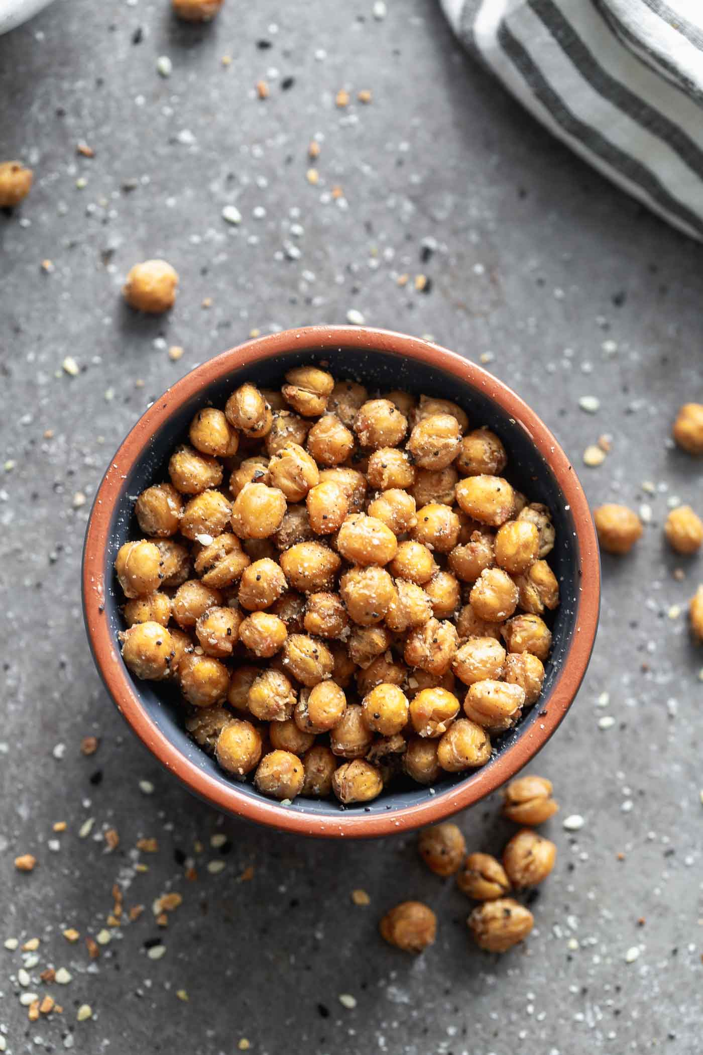 Crispy Everything Bagel Chickpeas are the perfect snack! They're covered in ground up everything bagel seasoning, tossed with olive oil and baked until golden brown and crispy. Store them in an airtight container and pull them out whenever you feel the need to snack!