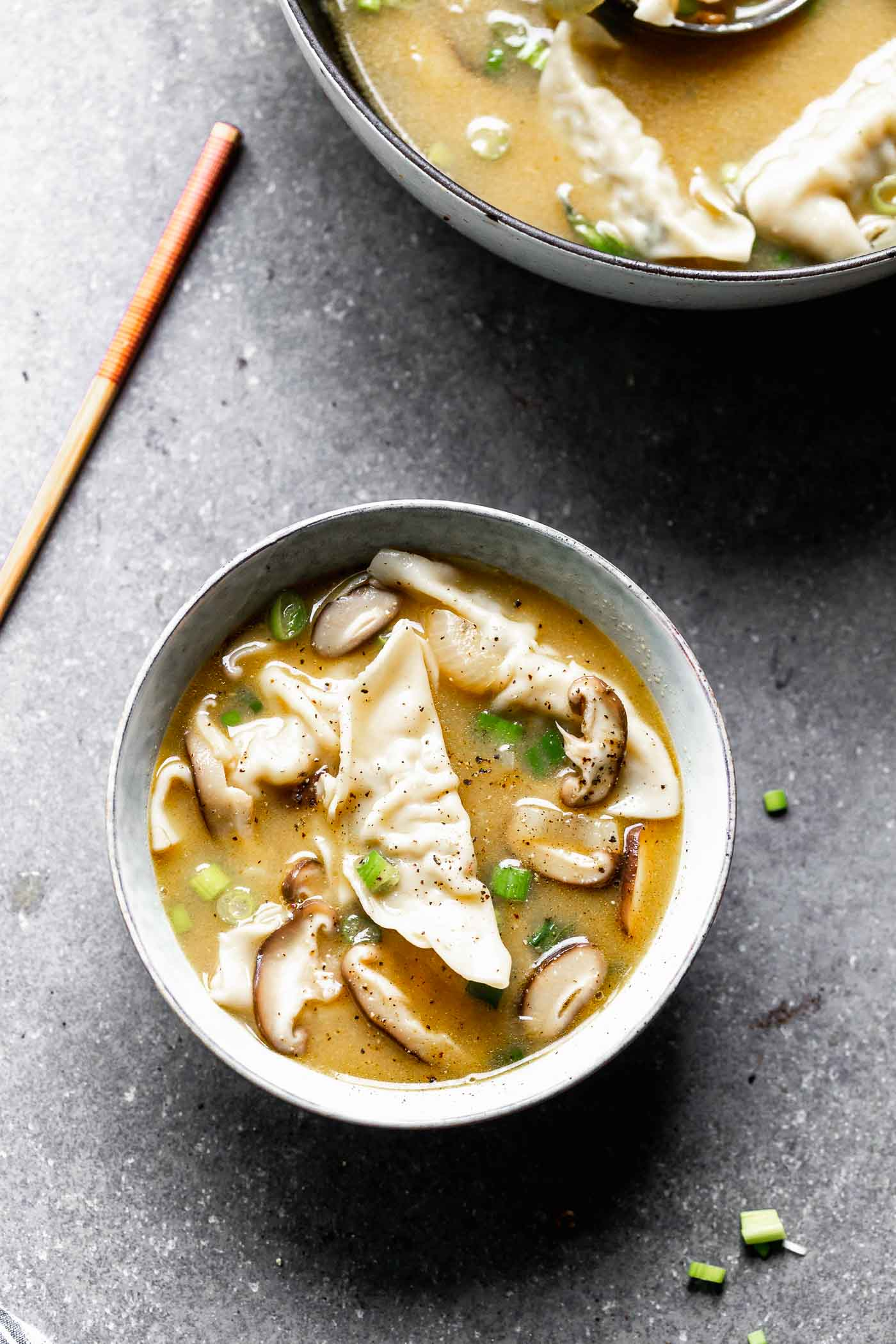 This Easy Wonton Soup takes a shortcut with frozen dumplings but doesn't take any shortcuts on flavor. The broth is packed with only a few ingredients - ginger, garlic, sesame and soy - but is SO flavorful. Earthy shiitake mushrooms and crisp green onions round it out!