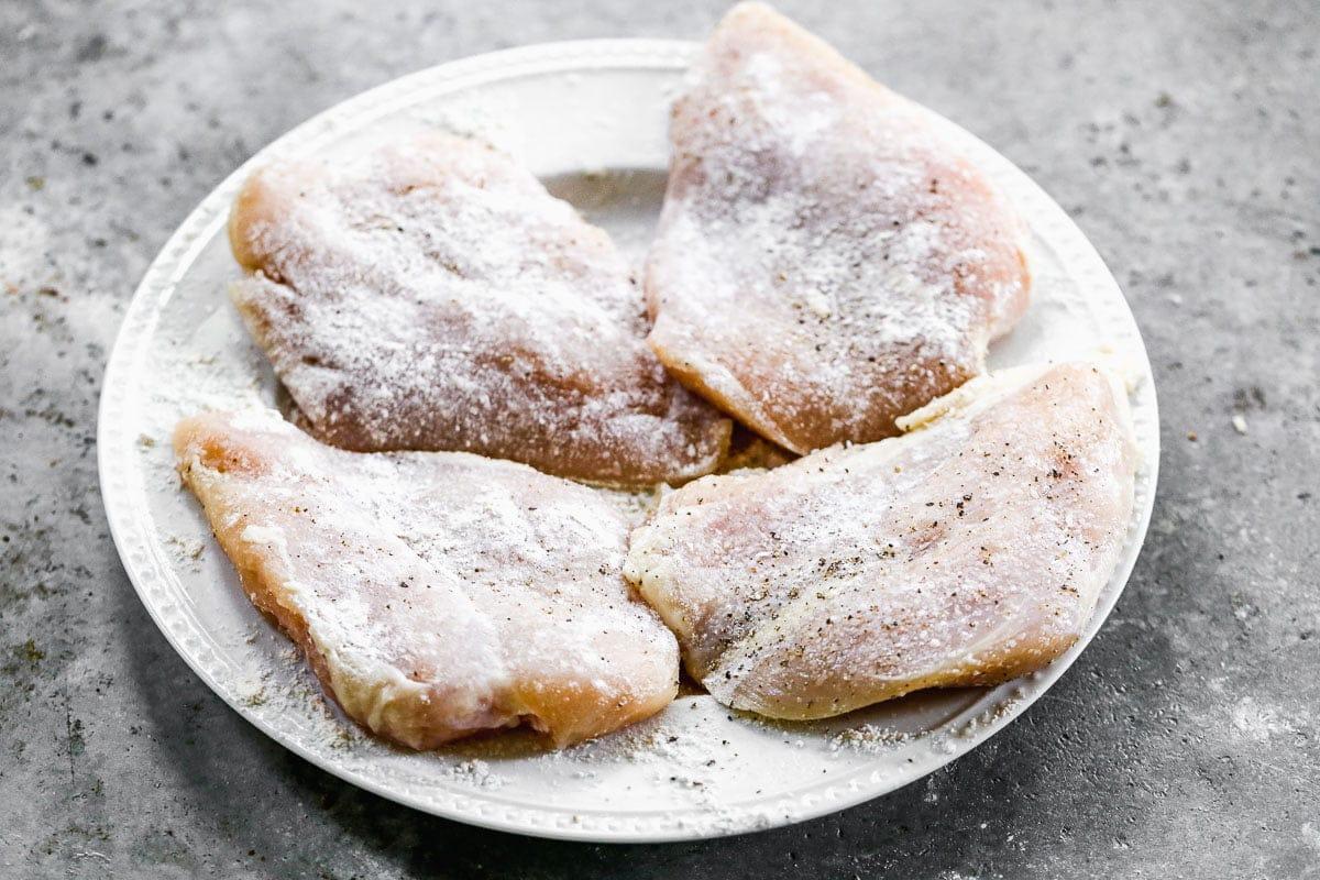 Chicken breasts dredged in flour
