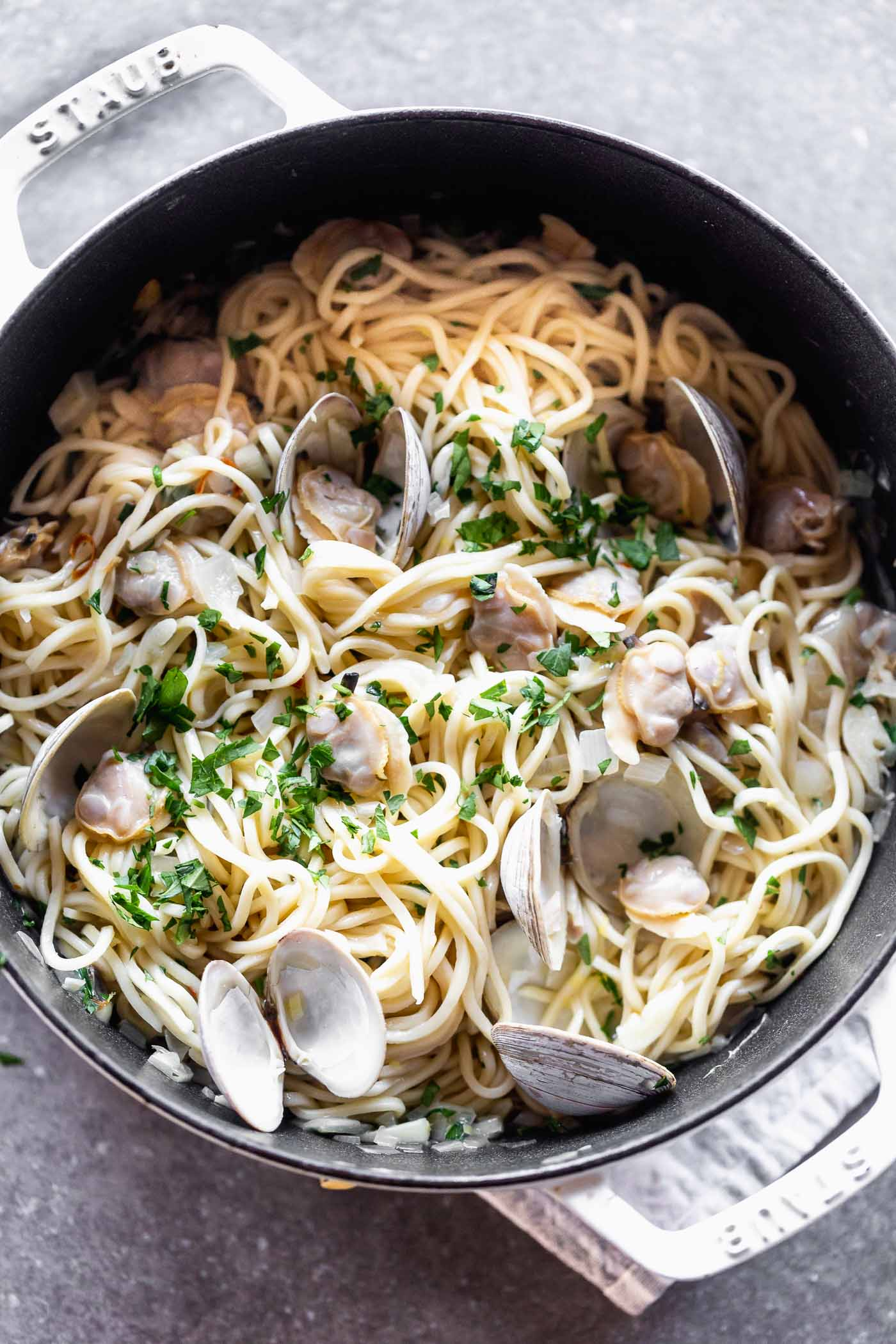 If you're a fan of light, ever-so-subtle seafood pasta, then this Easy Linguini with Clams is right in your wheelhouse. With a lemon and garlic-forward sauce, hints of red pepper flake, and delicate shallots, this meal has quickly become one of our favorites. It's also perfect for entertaining, which we love.