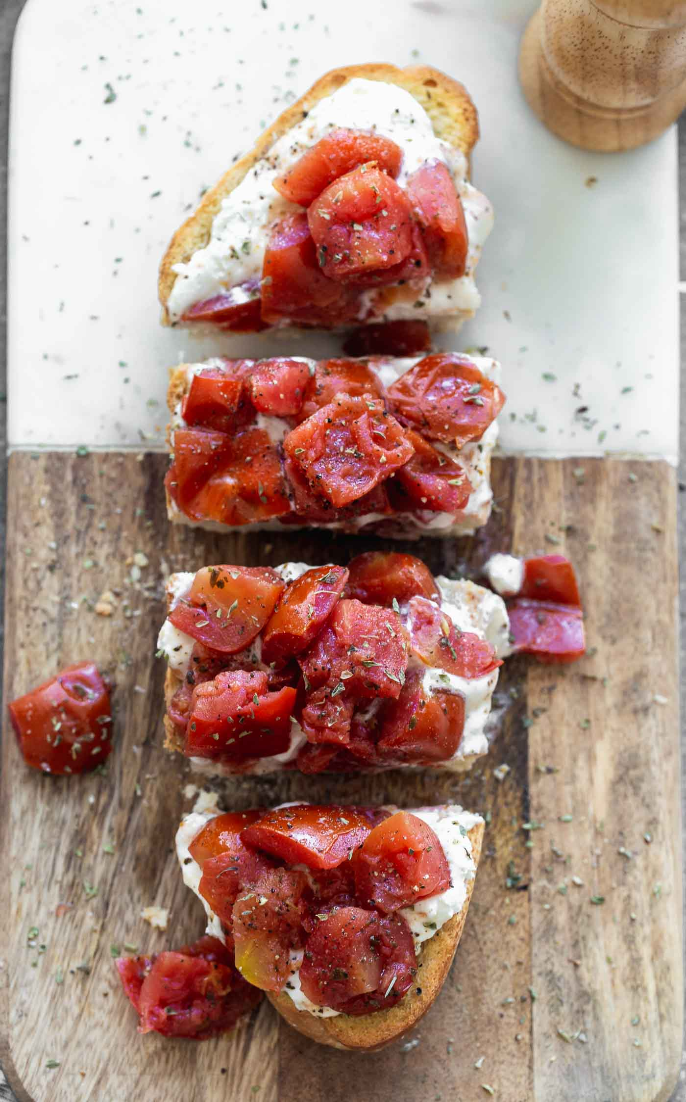 rispy French bread halves are seasoned with salt and pepper and baked until golden and crisp. They're brushed with garlic, then smothered with creamy whipped ricotta and topped with simply seasoned tomatoes. Serve with a crisp salad or as an appetizer!