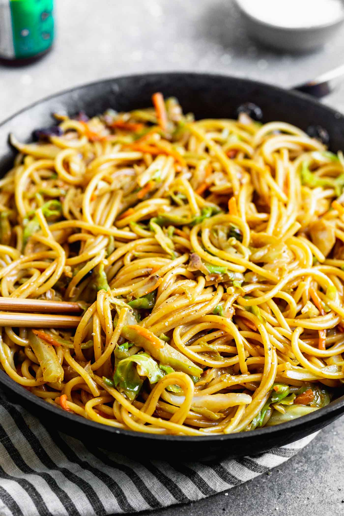 These 5-Ingredient Peanut Noodles are SO easy, and oh-so good. Thick spaghetti noodles are smothered in a hoisin-based peanut sauce, and tossed with a medley of cabbage and carrots for a delicious meal that comes together in minutes.