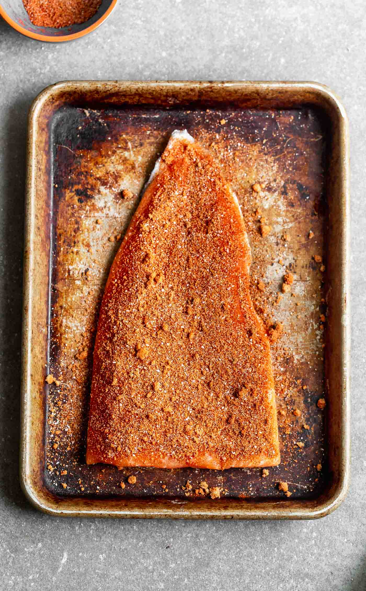 Press the rub into the side of the salmon.