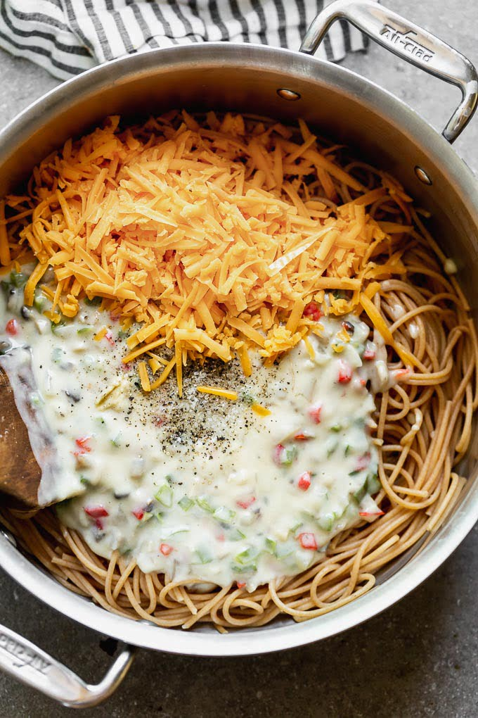 Add spaghetti, cream of mushroom sauce, cheese, chicken, and pimentos together.