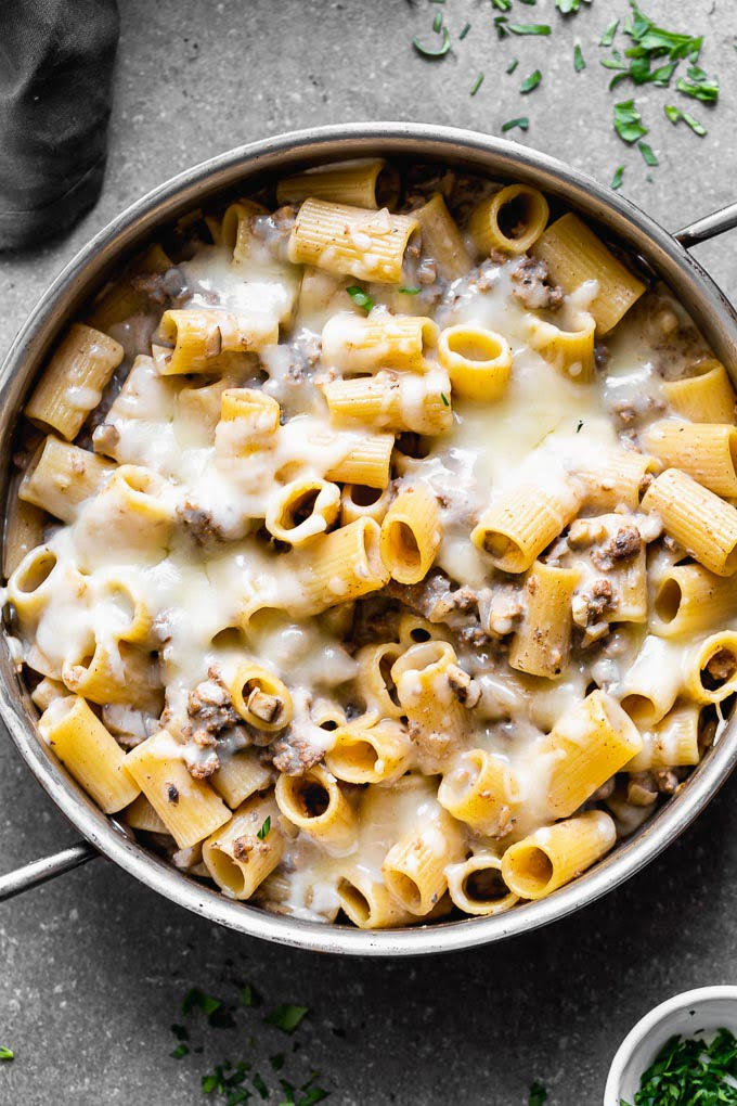 Cheesy Beef Stroganoff Pasta is a healthier, easier, and cheesier version of a classic! This stroganoff pasta is packed with seasoned ground beef, cremini mushrooms, perfectly aldente noodles and a creamy sauce made with Greek yogurt.