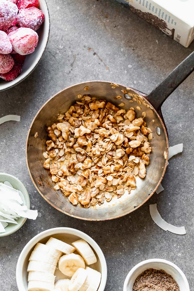 Walnut crumble with chopped walnuts, oats, honey, and coconut oil