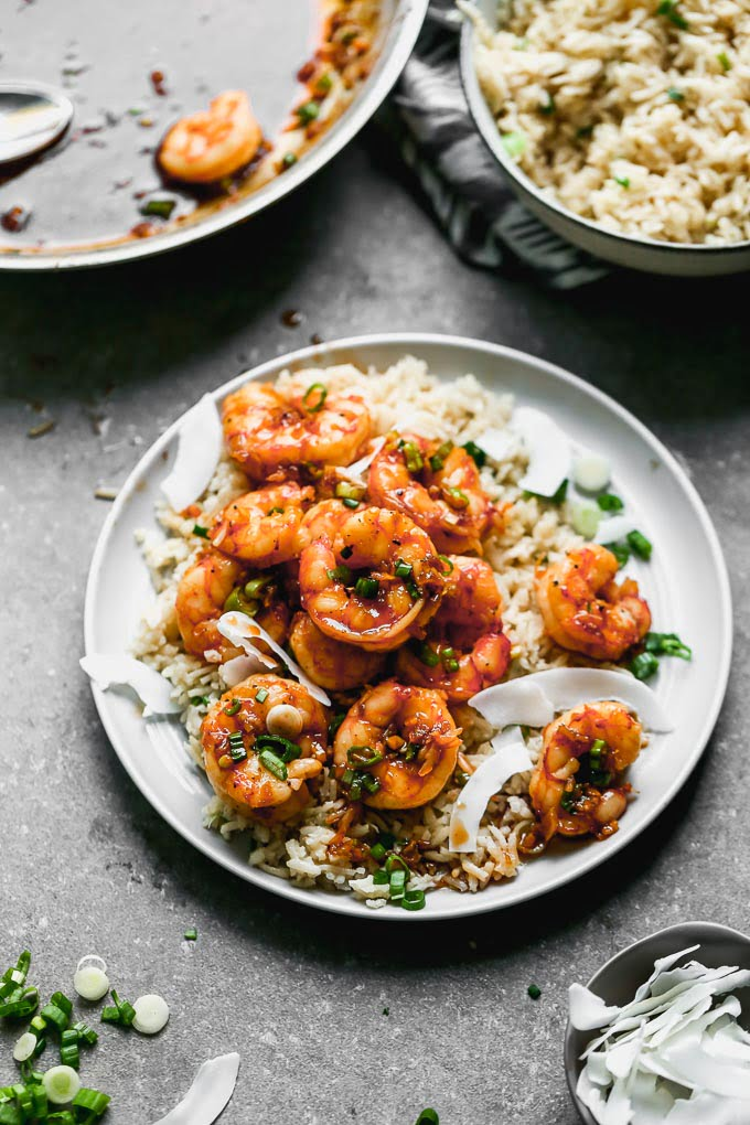 Caramel Shrimp with Coconut Rice: Sweet shrimp tossed in a salty brown sugar and soy sauce, studded with green onions, and served over coconut-infused rice to sop up all that delicious juice. Bonus? This is one of those 30-minute, no-fuss meals everyone in your family will love.