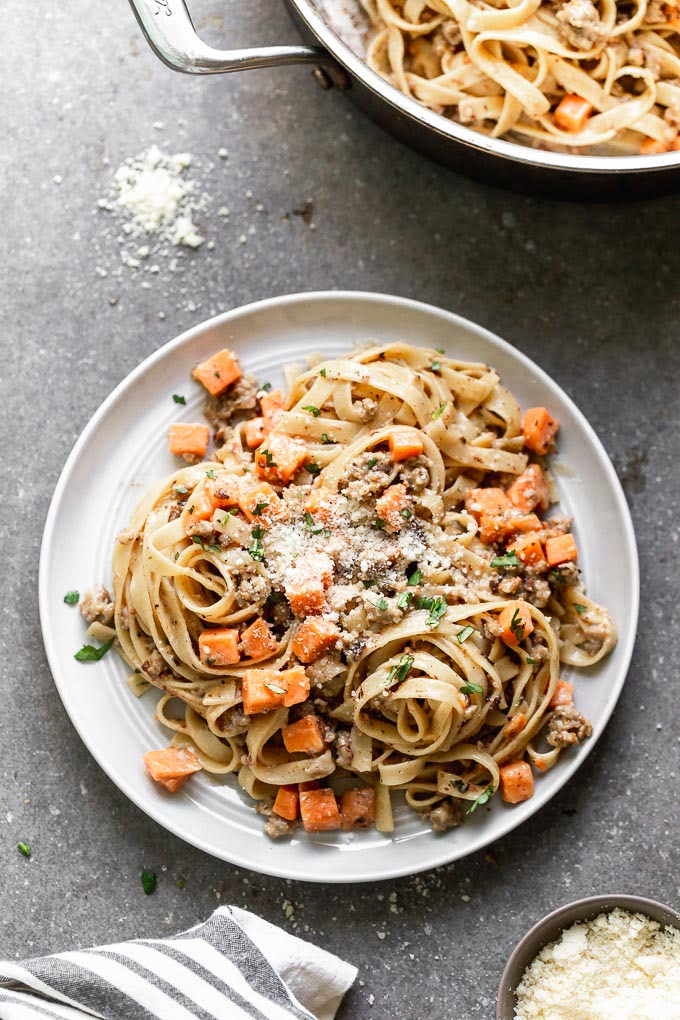Creamy Sausage Pasta topped with parmesan cheese