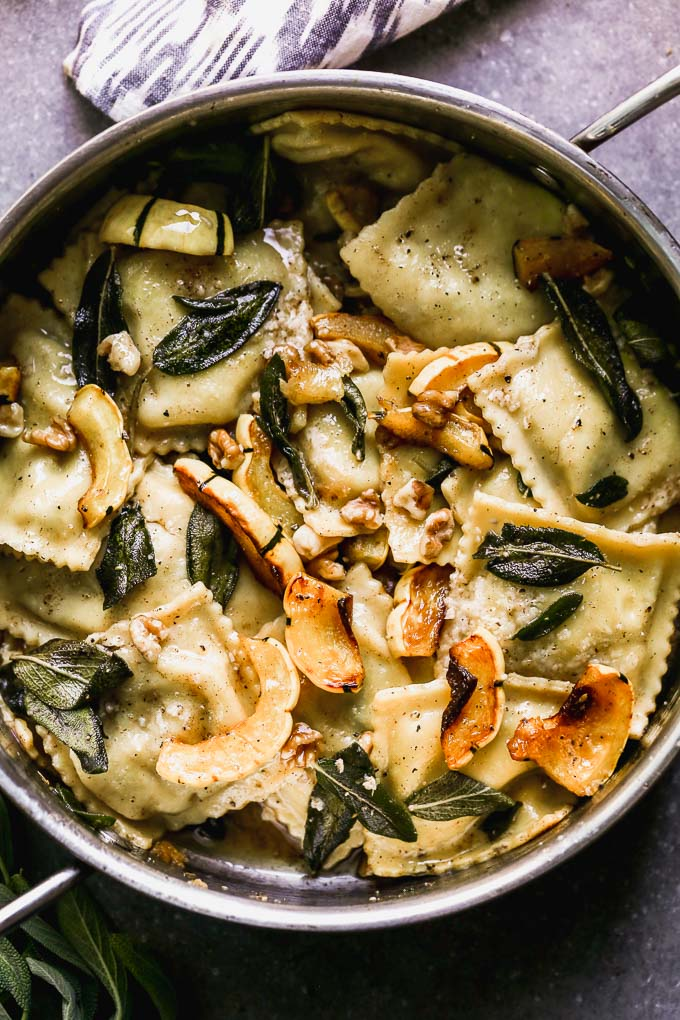 Ravioli with Brown Butter takes a simple store-bought ravioli and transforms it into a stunning dish perfect for a special occasion. This is packed with creamy sausage and ricotta-stuffed ravioli, an intoxicatingly nutty brown butter sauce, fried sage leaves, sweet roasted delicata squash, and crunchy walnuts. It's the perfect fall meal.