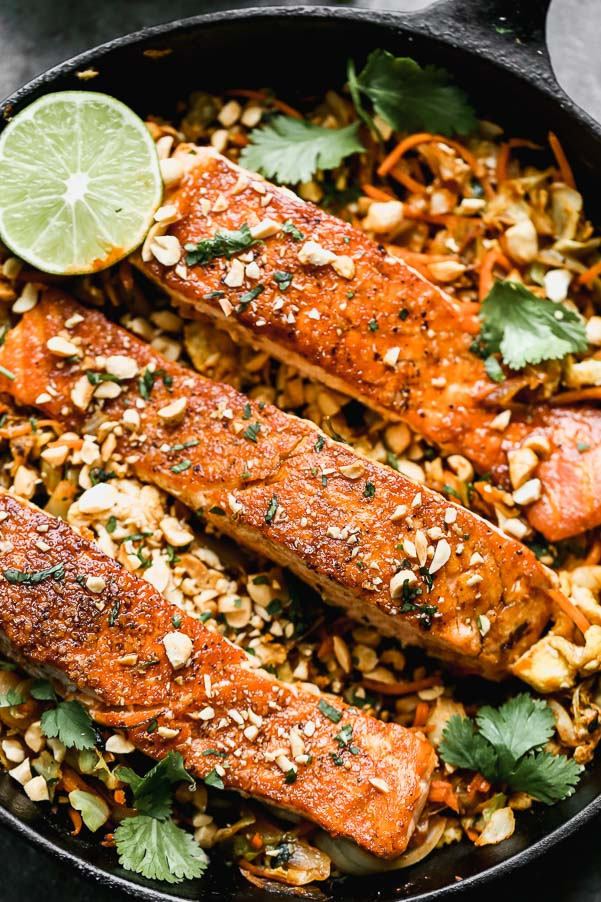 Pad Thai Salmon has all of the flavors of a classic pad Thai, but skips the noodles in lieu of sautéed veggies nestled beneath a crispy filet of salmon. Quick, easy, and healthy!