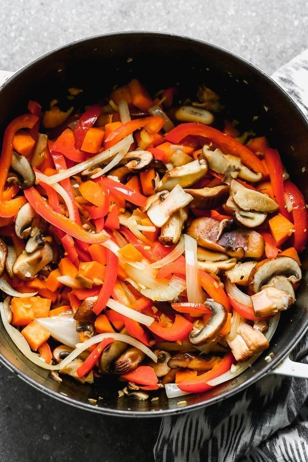 Saute mushrooms, sweet potato, onions, and red bell pepper.
